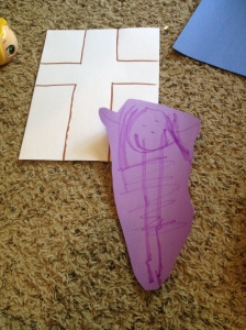 Our person and the cross. The kids have 4 angles to cut out, then we used the longer pieces to extend the arms of the cross.